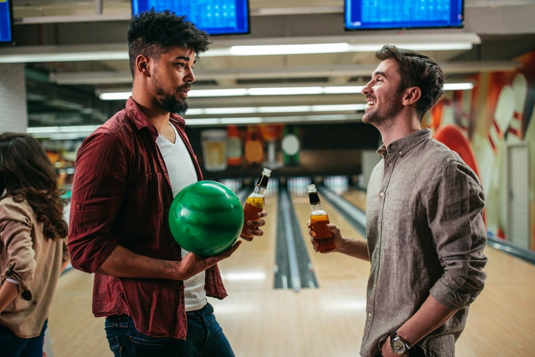 A couple bowling together