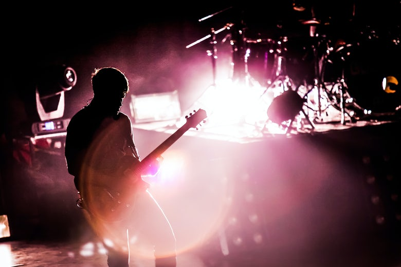 Guitarist at gig / shutterstock